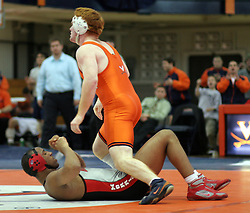 Brent Jones stands over OSU's Corey Morrison after pinning him at 1:58 in the first period of the 197lb division.  Jones had the only fall of the match, but UVA lost the meet to Ohio State, 28-10.