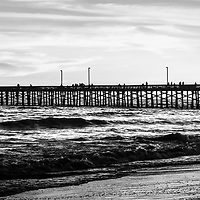Newport Beach Pier black and white panorama picture. Newport Pier is located on Balboa Peninsula and is a popular attraction along the Pacific Ocean in Orange County Southern California. Image Copyright © 2012 Paul Velgos with All Rights Reserved.