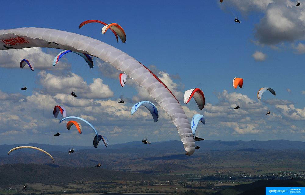149 of the World's best paragliding pilots from 39 nations descended on the small country town of Manilla near Tamworth in northern New South Wales, Australia to contest the 10th FAI Paragliding World Championships during March 2007. The drought stricken area is renowned for it's great cross country flying from the Mount Borah hillside and over two hectic weeks, numerous incidents and mixed weather, the pilots were able to fly five tasks to decide the winners in what proved to be an extremely close contest.. The Men's competition was won by Great British pilot Bruce Goldsmith with Jean-Marc Caron of France finishing second just seventeen points behind with Thomas Mccune of USA finishing third. The women's competition was won by Petra Slivova of Czech Republic with Viv Williams of Australian just fifteen points behind and New Zealand pilot Harmony Gaw finishing third. .In the team event Czech Republic finished first followed by France and Switzerland...Pilots take to the skies during competition where they form gaggle's and look for the best lift from thermal's...Pilots take to the skies during competition where they form gaggle's and look for the best lift from thermal's...