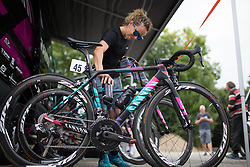 CANYON//SRAM Racing soigneur puts the race bidons on the bike of Alexis Ryan (USA) before the start of the 121.5 km road race of the UCI Women's World Tour's 2016 Grand Prix Plouay women's road cycling race on August 27, 2016 in Plouay, France. (Photo by Balint Hamvas/Velofocus)