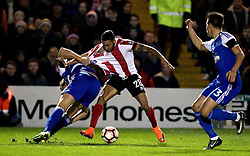 Nathan Arnold of Lincoln City has his shirt pulled by Christophe Berra of Ipswich Town - Mandatory by-line: Robbie Stephenson/JMP - 17/01/2017 - FOOTBALL - Sincil Bank Stadium - Lincoln, England - Lincoln City v Ipswich Town - Emirates FA Cup third round replay
