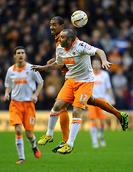 Blackpool Forward Gary Taylor-Fletcher (ENG) and Wolves Midfielder Karl Henry (ENG) compete in the air during the first half of the match - Photo mandatory by-line: Rogan Thomson/JMP - Tel: Mobile: 07966 386802 26/01/2013 - SPORT - FOOTBALL - Molineux Stadium - Wolverhampton. Wolverhampton Wonderers v Blackpool - npower Championship.