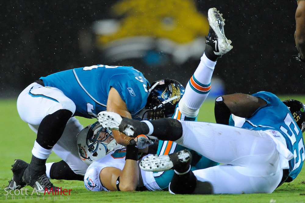 Aug. 21, 2010; Jacksonville, FL, USA; Miami Dolphins wide receiver Brian Hartline (82) is tackled by Jacksonville Jaguars linebacker Russell Allen (50) and linebacker Kirk Morrison (55) at EverBank Field. ©2010 Scott A. Miller