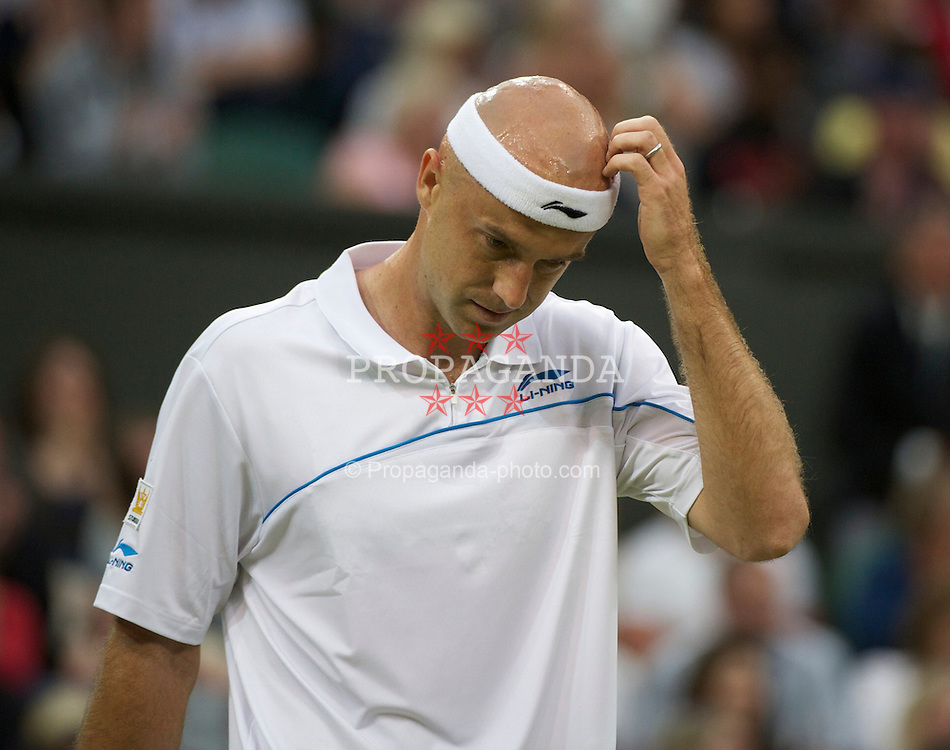 LONDON, ENGLAND - Friday, June 24, 2011: Ivan Ljubicic (CRO) in action during the Gentlemen's Singles 3rd Round match on day five of the Wimbledon Lawn Tennis Championships at the All England Lawn Tennis and Croquet Club. (Pic by David Rawcliffe/Propaganda)