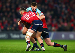 Henry Slade of Exeter Chiefs is tackled by Dan Goggin and Niall Scannell of Munster Rugby - Mandatory by-line: Ken Sutton/JMP - 19/01/2019 - RUGBY - Thomond Park - Limerick,  - Munster Rugby v Exeter Chiefs -