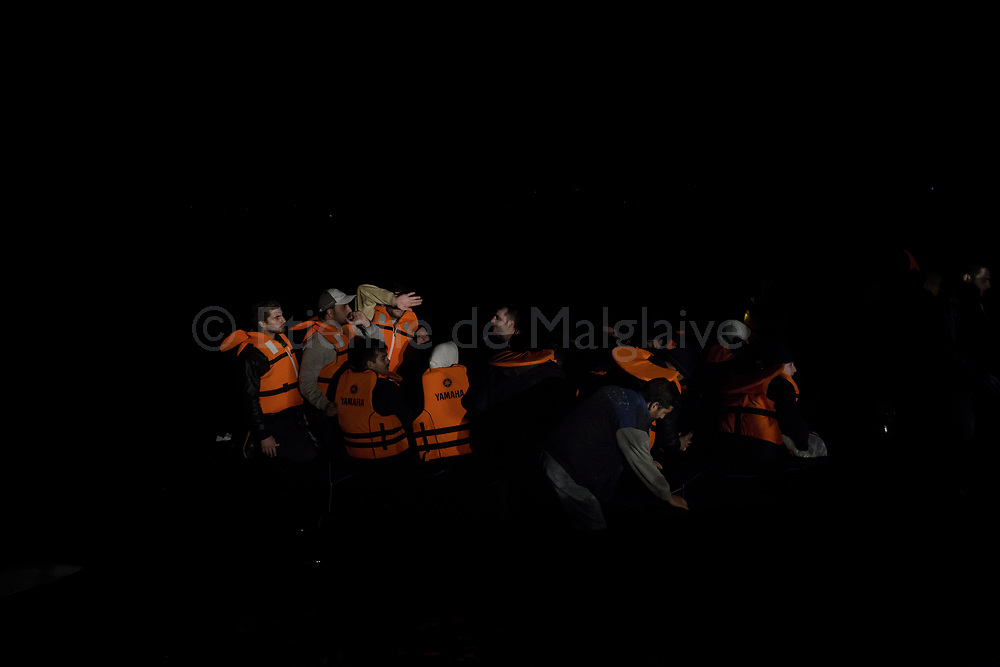 On a crowed inflatable boat, refugees from Afghanistan and Syria land at dark evening  on the northern shores of Lesbos in Skala Sikaminias, Greece on 04 November, 2015. Lesbos, the Greek vacation island in the Aegean Sea between Turkey and Greece, faces massive refugee flows from the Middle East countries.