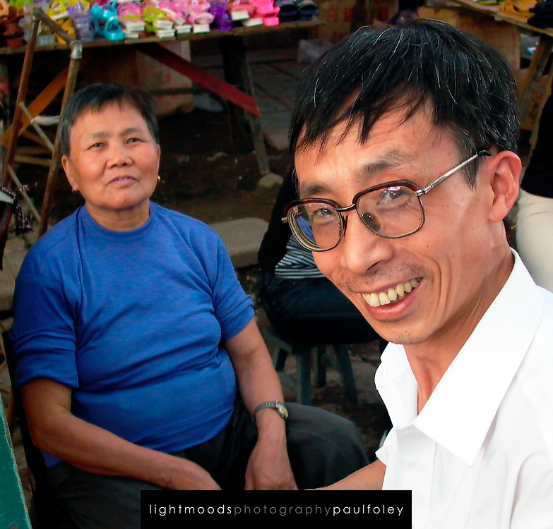 Man and woman at markets, Duyun, Guizhou Province, China.
