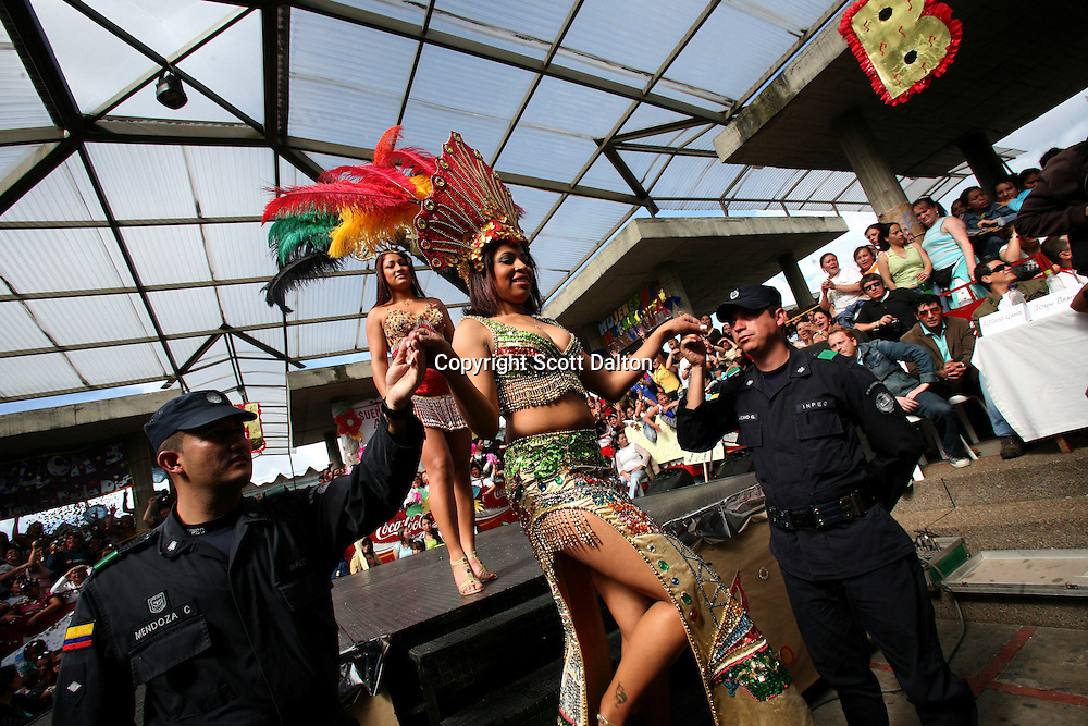 Angelica Zuniga, 22, an inmate from cellblock 5 serving time for falsifying documents, is helped off stage by guards during the prison beauty pageant at the Good Shepard Prison, a female prison, in Bogotá, Colombia on Friday, September 21, 2007. Each September, the female inmates of the Good Shepherd Prison hold a beauty pageant in honor of the Virgin of Mercedes, the patron saint of prisoners. This year is the first year that the prison held two beauty contests, one for elderly inmates and another for the regular aged inmates. (Photo/Scott Dalton)
