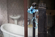 Old blue ribbon is attached to rusting gates at the entrance of a local bathroon fittings business, on 8th October 2019, in Rainham, Essex, England. Voters in this Havering borough voted 69% in favour of Brexit during the 2016 referendum.