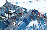 October 2005 - Yunnan, China - A tent of Tibetan Buddhist prayer flags hang from their lines.<br /> Photo credit: Luke Duggleby