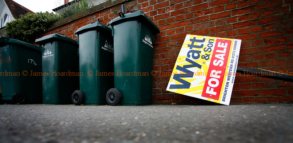 JAMES BOARDMAN / 07967642437<br /> A For Sale board lies next to some dust bins on Dyke Road, Brighton.