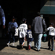 Fans arrive at Yankee Stadium during the New York Yankees Vs Toronto Blue Jays season opening day at Yankee Stadium, The Bronx, New York. 6th April 2015. Photo Tim Clayton