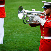 "United States Marine Drum and Bugle Corps, known as ""The Commandant's Own,"" performing at the Marine Corps Sunset Parade at the Marine Corps Memorial (Iwo Jima Memorial) next to Arlington National Cemetery. Editorial use only."