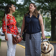 ARLINGTON, VA -JUNE3:  Tiffany Jolliff, talks with lawyer Deepa Goraya, from the the Washington Lawyers' Committee for Civil Rights and Urban Affairs, after they filed a lawsuit Thursday in federal district court in the Eastern District of Virginia on behalf of Tiffany Jolliff against Uber, alleging violations of the Americans With Disabilities Act and the Virginians with Disabilities Act, alleging Uber unlawfully refused to accommodate Jolliff, who is blind, and her service dog, Railey. The complaint alleges that Jolliff, who works as a policy specialist for the federal government on employment for workers with disabilities, has been repeatedly discriminated against and denied Uber's services when Uber's drivers have seen that she is accompanied by her service dog Railey. Specifically, instead of accommodating her service dog Railey, as both the ADA and VDA require, Uber drivers have repeatedly driven off upon seeing that Ms. Jolliff had a service dog. (Photo by Evelyn Hockstein/For The Washington Post)