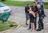 Person being arrested in Baton Rouge. After a fatal police shooting of Alton Sterling last week, there have been multiple protests. At least 48 people had been were taken into custody by midnight Sunday,