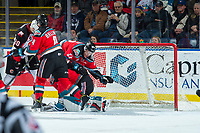 KELOWNA, CANADA - NOVEMBER 29: Conner Bruggen-Cate #20 and Gordie Ballhorn #4 collide with James Porter #1 of the Kelowna Rockets against the Prince George Cougars on November 29, 2017 at Prospera Place in Kelowna, British Columbia, Canada.  (Photo by Marissa Baecker/Shoot the Breeze)  *** Local Caption ***
