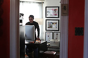 Teresa Scott, the founder of Women's World of Boxing, works in her New Jersey home office on Thursday, Nov.14, 2013. Photo credit: Tanisia Morris/NYCity Photo Wire