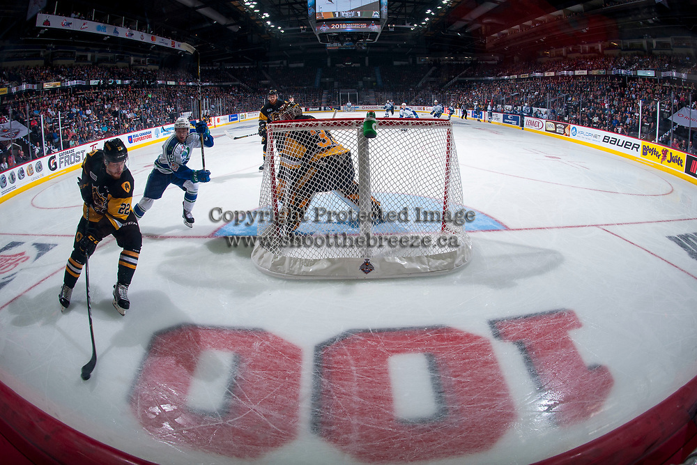 REGINA, SK - MAY 21: Beck Malenstyn #19 of Swift Current Broncos back checks Jack Hanley #22 as he skates behind the net of Kaden Fulcher #33 of Hamilton Bulldogs at the Brandt Centre on May 21, 2018 in Regina, Canada. (Photo by Marissa Baecker/CHL Images)