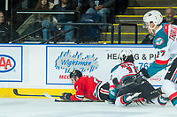 KELOWNA, CANADA - APRIL 8: Brendan De Jong #21 of the Portland Winterhawks is checked to the ice by Nick Merkley #10 of the Kelowna Rockets on April 8, 2017 at Prospera Place in Kelowna, British Columbia, Canada.  (Photo by Marissa Baecker/Shoot the Breeze)  *** Local Caption ***