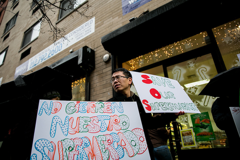 NEW YORK, NY - DECEMBER 29, 2016: Community members rally against the closing of the Met Foodmarket outside the store in the Little Italy neighborhood in New York, New York. CREDIT: Sam Hodgson for The New York Times.
