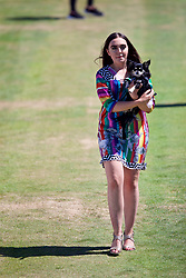 LIVERPOOL, ENGLAND - Friday, June 22, 2018: Models with dogs walk onto Centre Court during a fashion show during day two of the Williams BMW Liverpool International Tennis Tournament 2018 at Aigburth Cricket Club. (Pic by Paul Greenwood/Propaganda)