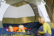 Kirsten Sabin telling children Elise and Chase camp stories in tent near Whitefish Montana model released