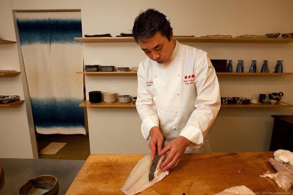 Hiroyuki Kanda while preparing fish for sushi at the Kanda restaurant in Tokyo.