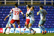 Kyle McFadzean of Coventry City (5) and Freddie Ladapo of Rotherham United (10) wrestle each other for the ball during the EFL Sky Bet League 1 match between Coventry City and Rotherham United at the Trillion Trophy Stadium, Birmingham, England on 25 February 2020.