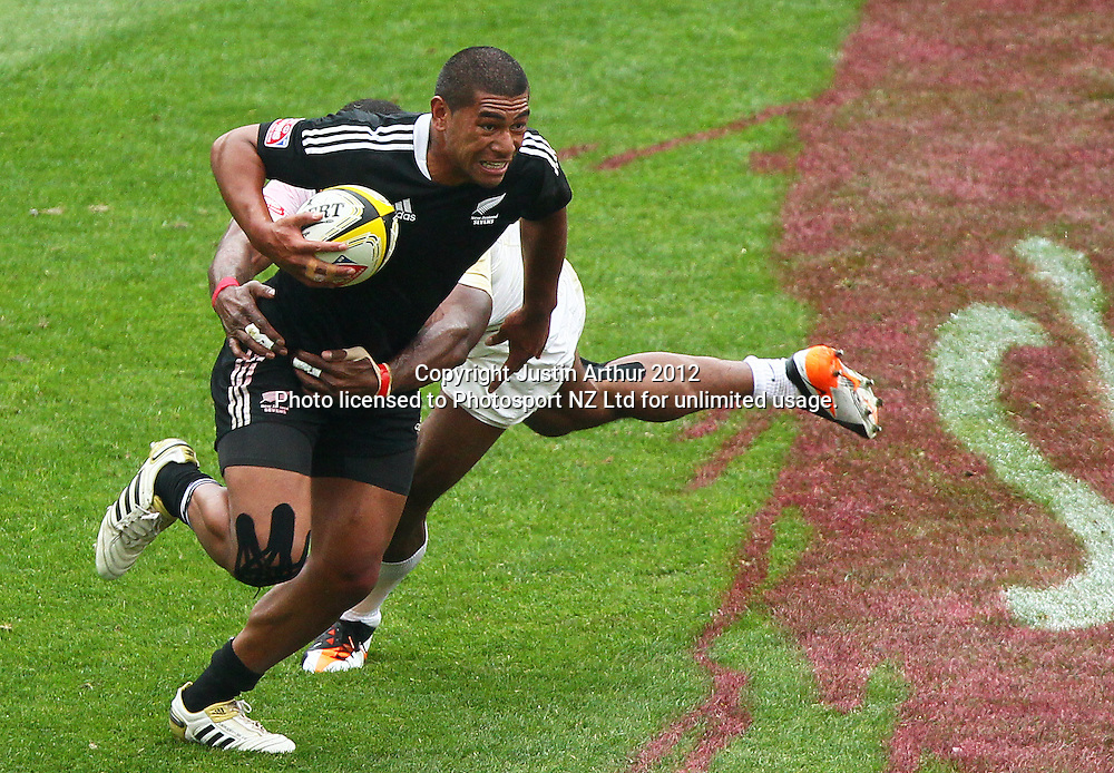 New Zealand's Charles Piutau on the attack. Hertz Wellington Sevens - Day two at Westpac Stadium, Wellington, New Zealand on Saturday, 4 February 2012. Photo: Justin Arthur / photosport.co.nz