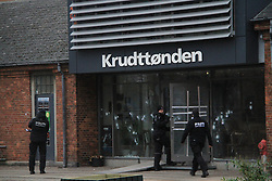 Danish policemen stand guard at the cultural center Krudttoenden, where a man was killed and three police officer were wounded, in Copenhagen, Feb. 15, 2015. Copenhagen's police director Thorkild Fogde said at a press conference that the police have identified the alleged offender, who was killed by police early Sunday morning in the Noerrebro neighborhood in Copenhagen. EXPA Pictures © 2015, PhotoCredit: EXPA/ Photoshot/ Shi Shouhe<br /> <br /> *****ATTENTION - for AUT, SLO, CRO, SRB, BIH, MAZ only*****