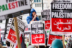 London, August 23rd 2014. A young man leads anti-Israeli chants as hundreds of protesters demonstrate outside Downing Street, demanding that Britain stops arming Israel.