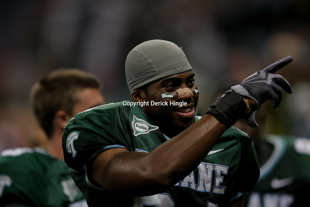 Sep 26, 2009; New Orleans, LA, USA; Tulane Green Wave safety Chinonso Echebelem (24) celebrates after the game against the McNesse State Cowboys at the Louisiana Superdome. Tulane defeated McNeese State 42-32. Mandatory Credit: Derick E. Hingle-US PRESSWIRE