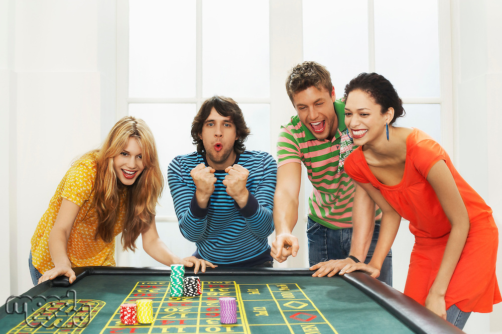 Friends celebrating win on roulette table
