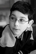 Young boy wearing glasses