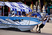 "SHOT 1/11/10 9:30:46 AM - A group of tourists prepares to launch a boat before heading out on a fishing trip into the Pacific Ocean in Sayulita, Mexico. Sayulita is a small fishing village about 25 miles north of downtown Puerto Vallarta in the state of Nayarit, Mexico, with a population of approximately 4,000. Known for its consistent river mouth surf break, roving surfers ""discovered"" Sayulita in the late 60's with the construction of Mexican Highway 200. In recent years, it has become increasingly popular as a holiday and vacation destination, especially with surfing enthusiasts and American and Canadian tourists. (Photo by Marc Piscotty / © 2009)"