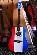The iconic red white and blue Acoustic Guitar  that is the favorite of Buck Owen from Bakersfield, California  is one of the hundreds of guitars sold at Front Porch Music on 19th Street in downtown Bakersfield. <br />
