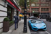 London, England, UK, February 5 2018 - Blue Lamborghini in front of Novikov restaurant in the Mayfair area, owned by Russian entrepreneur Arkady Novikov .