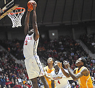 "Mississippi Rebels center Dwight Coleby (23) dunks as Tennessee Volunteers guard Robert Hubbs III (3) Mississippi Rebels forward M.J. Rhett (4), and Tennessee Volunteers forward Willie Carmichael III (24) look on at the C.M. ""Tad"" Smith Coliseum in Oxford, Miss. on Saturday, February 21, 2015. Mississippi won 59-57. (AP Photo/Oxford Eagle, Bruce Newman)"