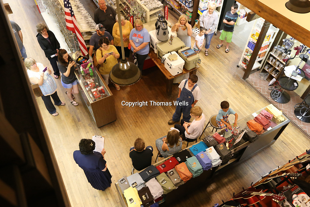 """Local Volunteers reenact a scene from Elevis' childhood at Lawnhood Elementary while festival goers look on at Tupelo Hardware Friday afernoon as part of the """"Characters on Main"""" portion of this year's Elvis Presley Festival."""