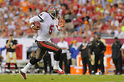Tampa Bay Buccaneers quarterback Josh Freeman (5) runs upfield during the Bucs game against the New Orleans Saints at Raymond James Stadium on Sept. 15, 2013 in Tampa, Florida. <br /> &copy;2013 Scott A. Miller