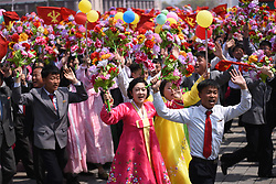 PYONGYANG, April 15, 2017  People with flowers in their hands attend a parade in central Pyongyang, April 15, 2017. The Democratic People's Republic of Korea (DPRK) Saturday showcased its military muscles by parading all of its most-advanced ballistic and tactic missiles, including a submarine-launched ballistic missile which could strike targets 1000 km away.  wtc) (Credit Image: © Cheng Dayu/Xinhua via ZUMA Wire)