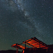 Milky way over the campfire lapa at the Noetsie camp on the Whale Trail, De Hoop Nature Reserve, South Africa.
