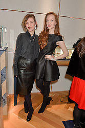 Left to right, CAMILLA RUTHERFORD and OLIVIA GRANT at a party to celebrate the launch of the APM Monaco Flagship Store at 3 South Molton Street, London on 11th February 2016