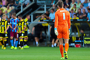 Scunthorpe's Luke Daniels makes a slow walk back to the dressing room following his red card for violent conduct during the Sky Bet League 1 match between Burton Albion and Scunthorpe United at the Pirelli Stadium, Burton upon Trent, England on 8 August 2015. Photo by Aaron Lupton.