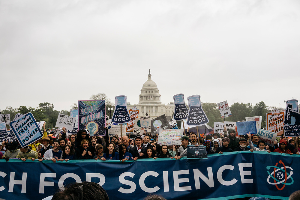 Protesters stand in front of the U.S. Capitol during the March for Science in Washington, D.C. on Earth Day 2017.