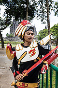 INDONESIA, Central Java, Prambanan Temple, young student making souvenir photos to the tourists