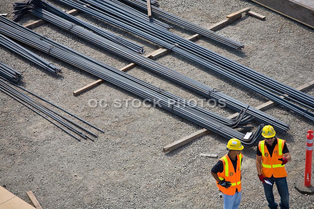 Construction Men Discussing A Plans