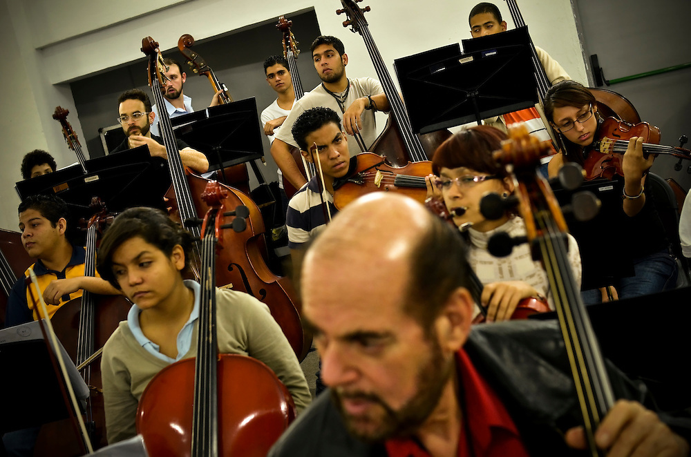 Members of LA Philharmonic rehearse with students involved in El Sistema in Caracas on February 15, 2012.