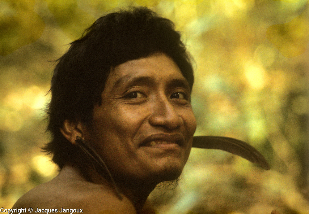 Portrait of Indian  man with feather ear ornaments in Guiana Highlands in Venezuela.