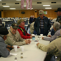 Local veterans socialize during a breakfast in their honor Nov. 11 at American Legion Post 26 in Aberdeen.